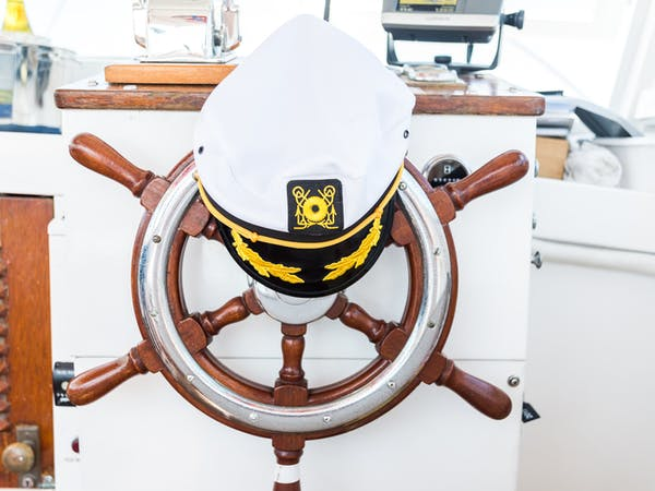 captain's hat on wheel private charter