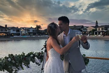 Wedding toast enjoyed on luxury yacht as wedding venue.