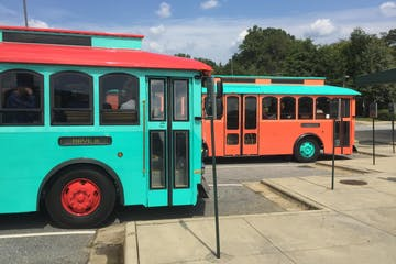 Two Trolleys, one orange and one teal
