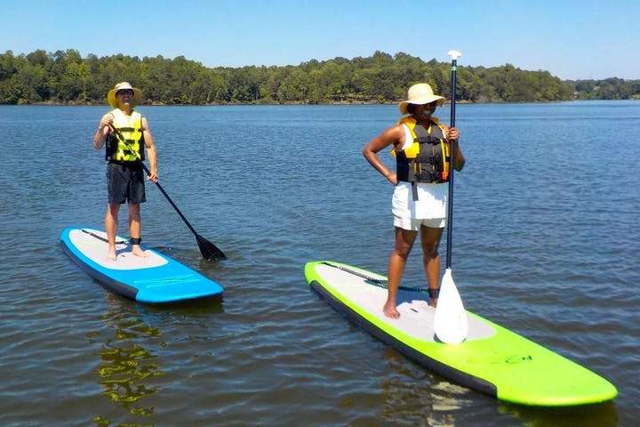 Couple on Stand Up Paddle boards on Oak Hollow Lake