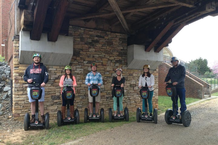 Group of friends on Segway PTs in Winston-Salem park