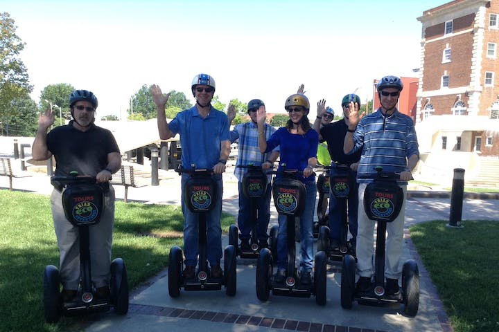 Group of people saying hi on a segway