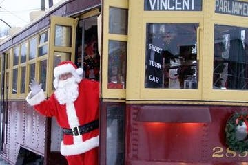 Santa Clause on a red trolley