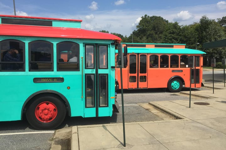 Two trolleys, one teal and the other is orange
