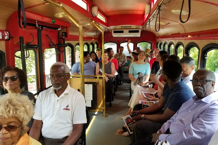 People riding on trolley