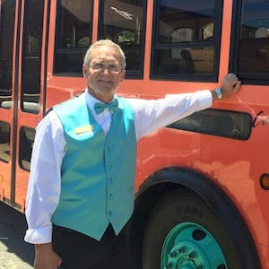 Charles Nelson Reilly standing in front of a bus