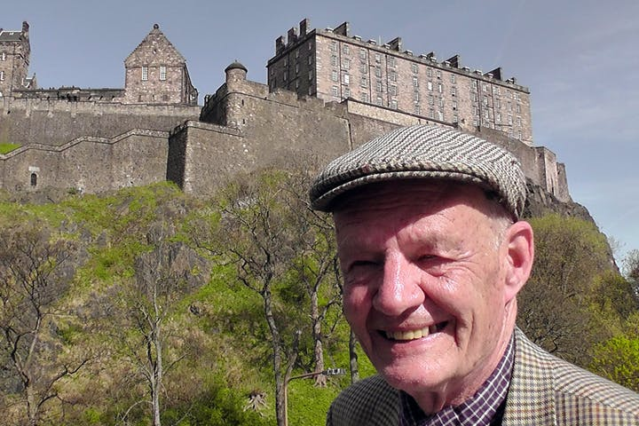 man infront of a castle
