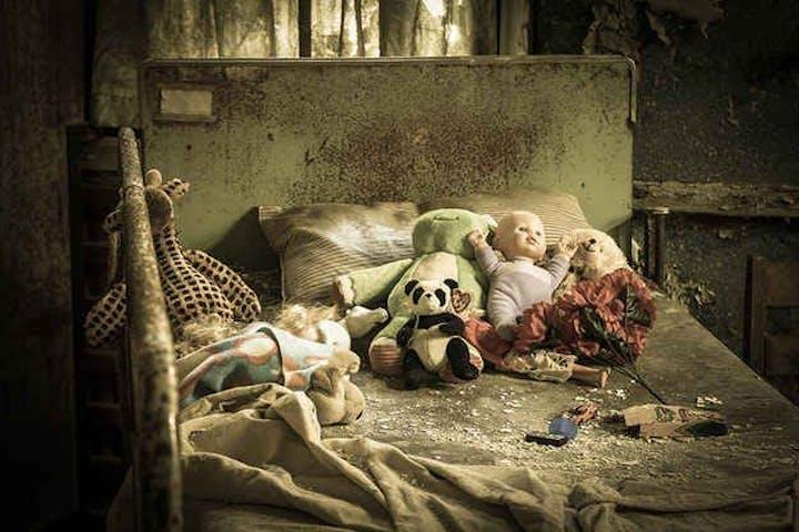 creepy bedroom with dolls
