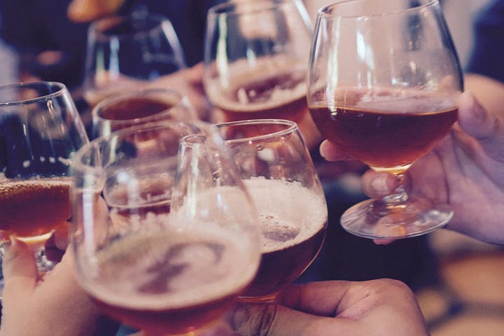 A close up picture of a group toasting