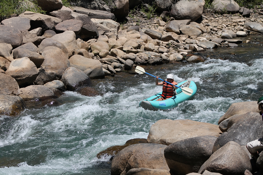 A woman on an inflatable kayak tour in Durango