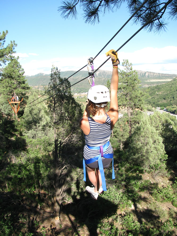 a woman on a zip line tour from Durango Rivertrippers and Adventure Tours