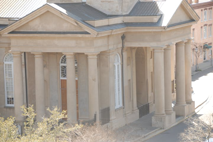 Huge lyme stone building with grecian columns