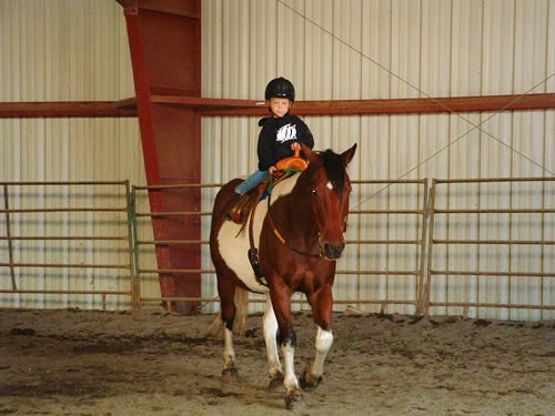 Young riding and roping team practicing.