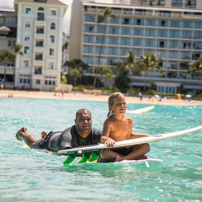 boy getting surf lesson honolulu