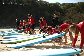A group of groms getting ready to head out on the water