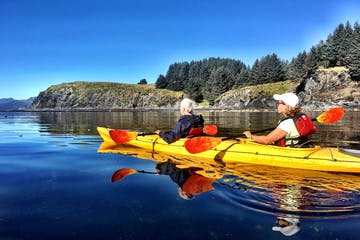 Kayakers on water in Kodiak Alaska