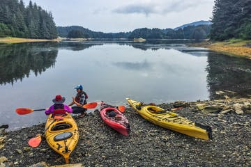 Kayaks on shore in Kodiak, Alaska