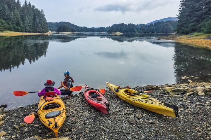 Kayaks on shore in Kodiak, Alaska