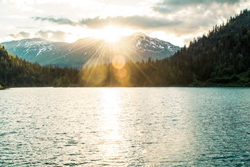 Sun over mountains in Kodiak, Alaska