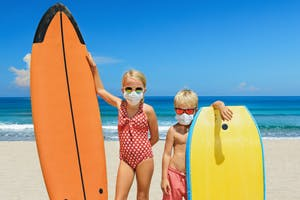 Kids enjoying Hawaii with masks