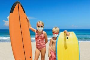 Kids enjoying Hawaii with masks