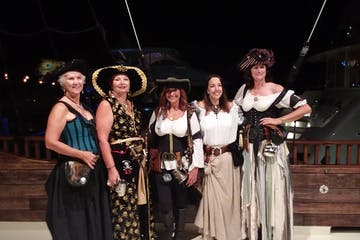 women dressed up in pirate gear