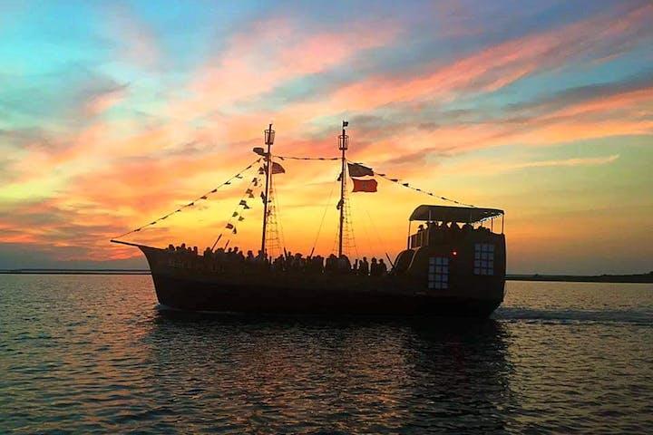 black pearl pirate ship at sunset