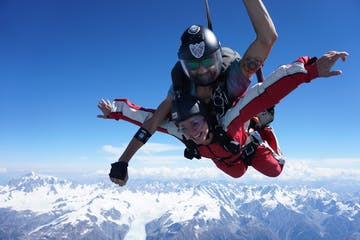 A woman enjoying her tandem skydive