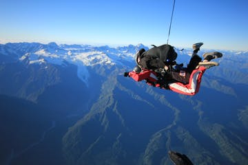 These two divers are soaring high above Franz Josef
