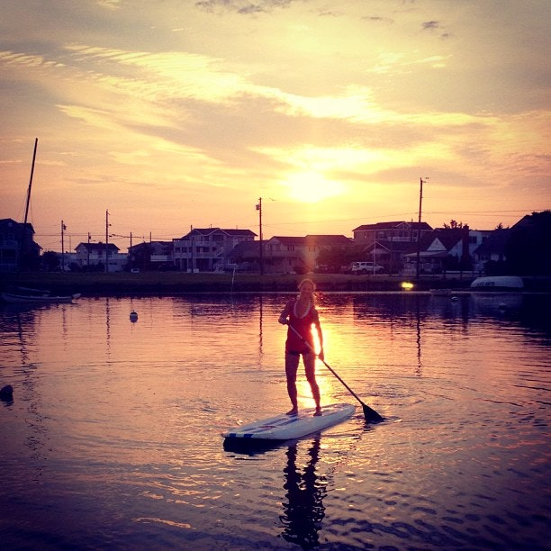 Stand up paddleboarding at sunset with LBI Surfing.