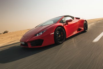 Red Lamborghini on the road.