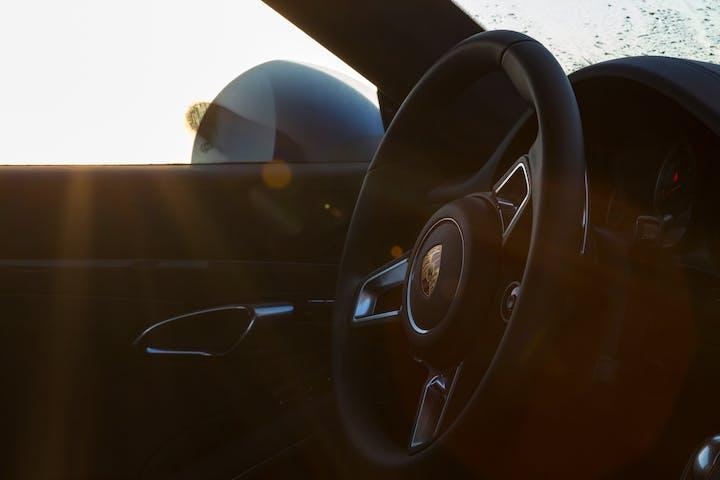 Black Porsche steering wheel.