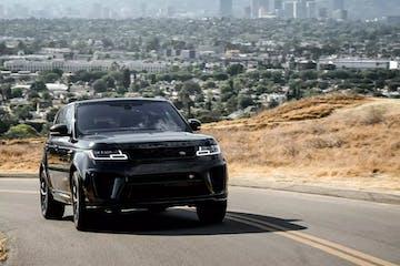 Black Range Rover in the city.