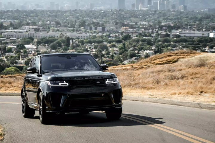 Black Range Rover in the city.