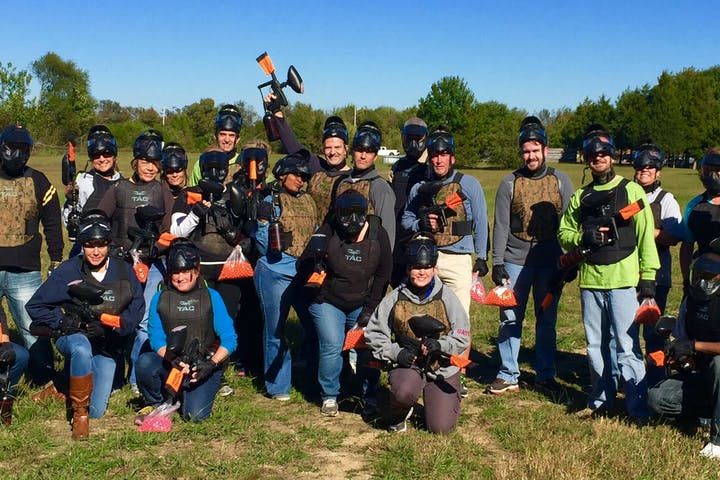 a large group of people with paintball guns