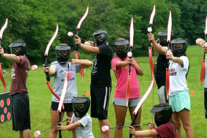 a group of girls playing arrow tag