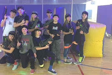 a group playing indoor mobile laser tag