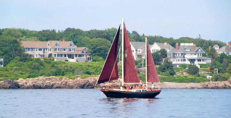 The Pineapple Ketch sails along the coastline in Kennebunkport.