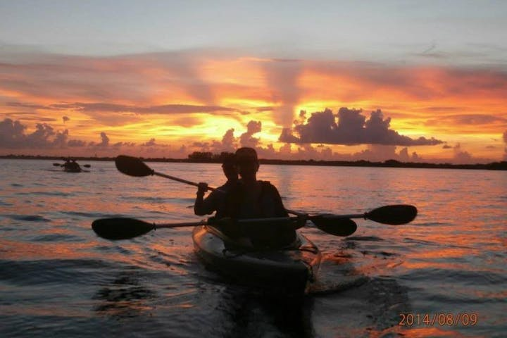 kayakers in sunset