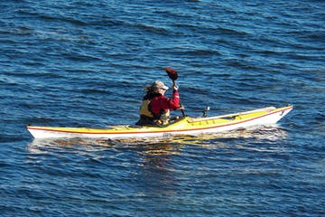 kayaker paddling in away