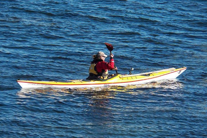 kayaker paddling in away