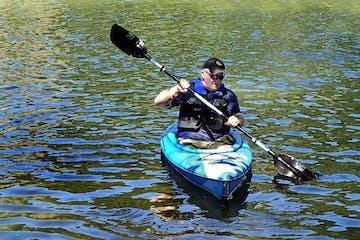 Old man kayaking
