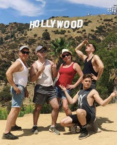 group posing in front of Hollywood sign