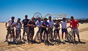 A group of people on bikes on the beach in Los Angeles