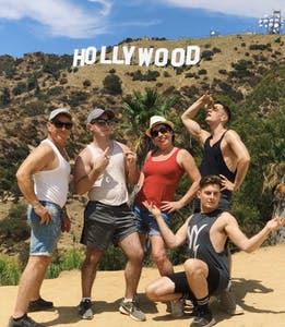 five people in front of hollywood sign