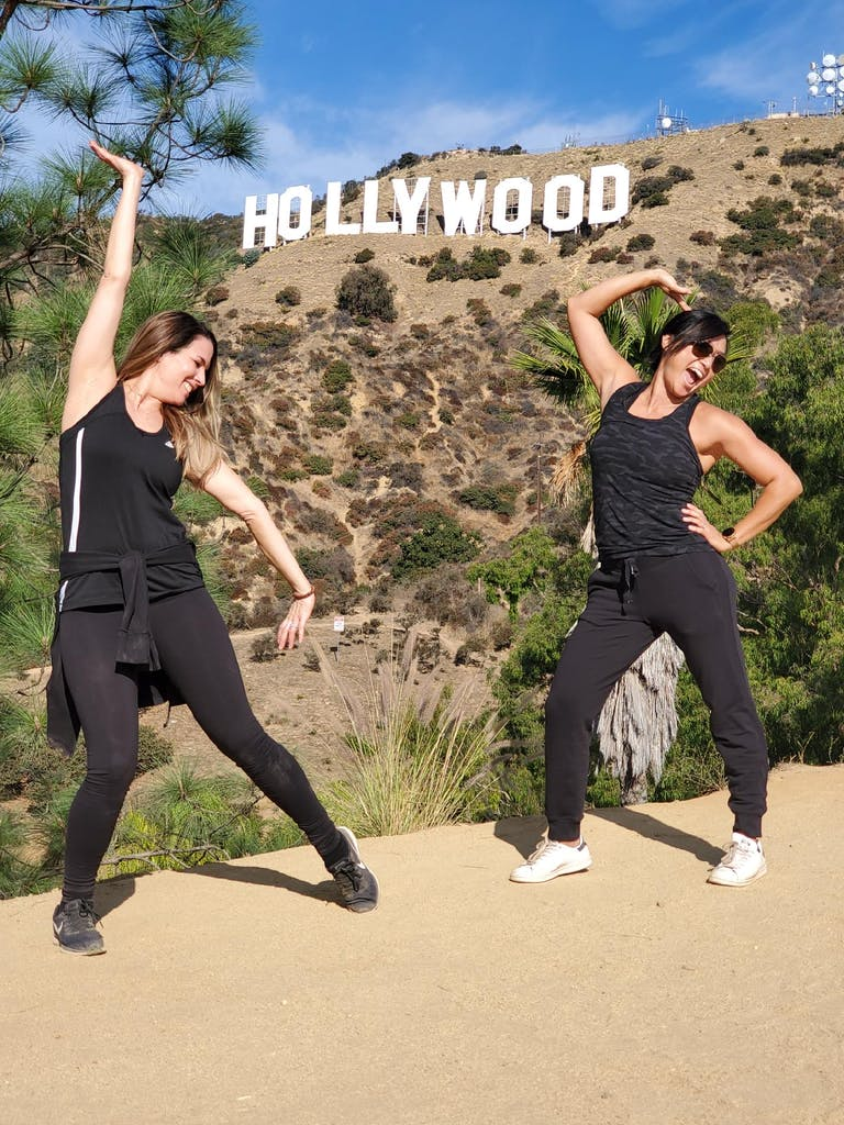 two girls in front of hollywood sign