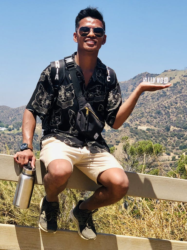a person holding the hollywood sign in their hand on our griffith park hike