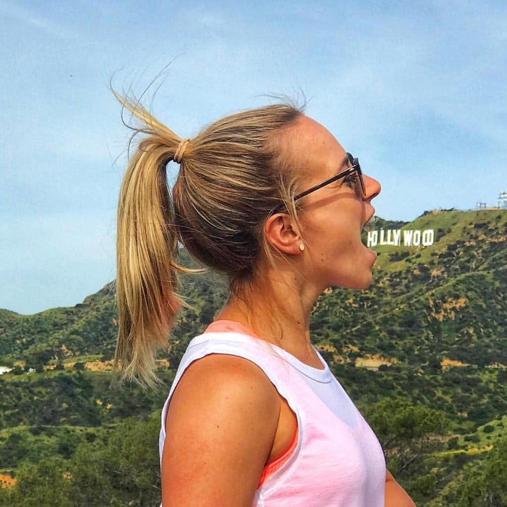 a person eating the hollywood sign on our griffith park hike