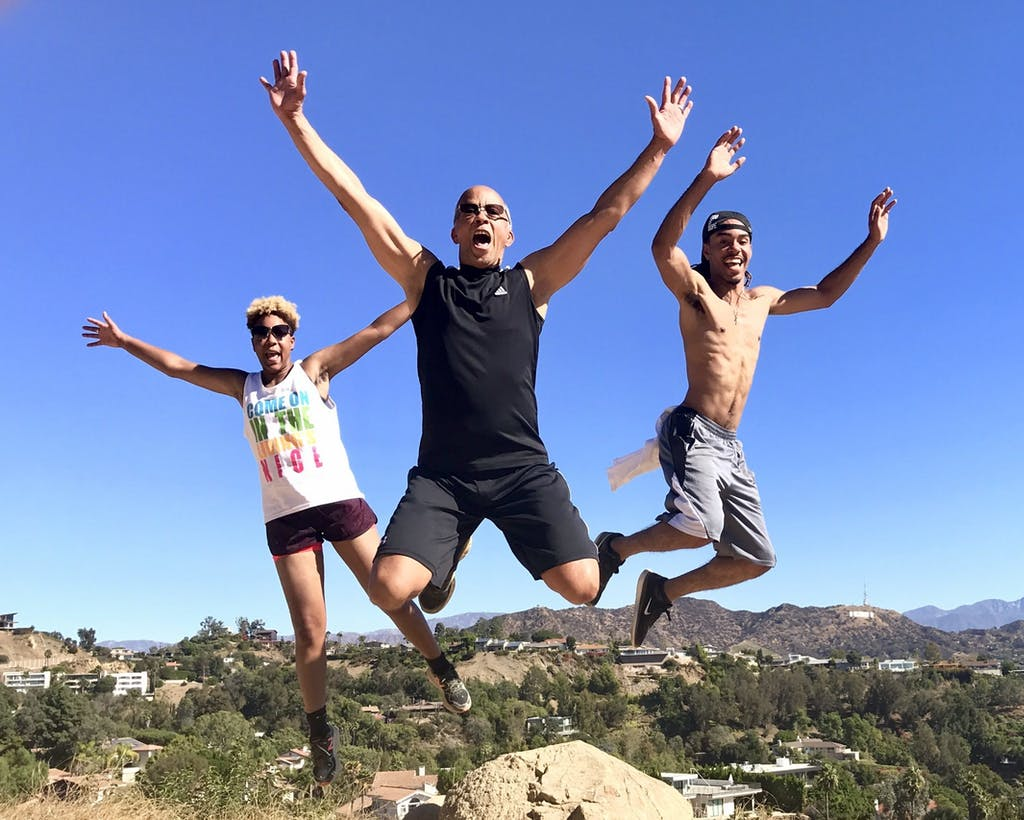 a group of people jumping in the air on a hollywood hills hike