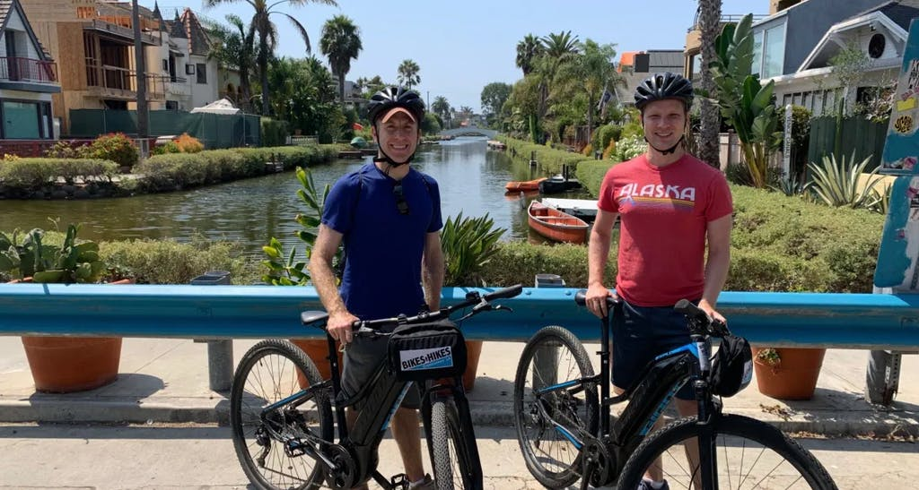 couple biking at the venice canals